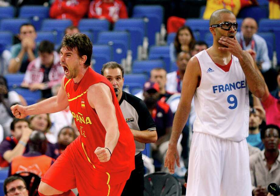 LONDON, ENGLAND - AUGUST 08:  Marc Gasol #13 of Spain reacts late in the fourth quarter alongside Tony Parker #9 of France during the Men's Basketball quaterfinal game on Day 12 of the London 2012 Olympic Games at North Greenwich Arena on August 8, 2012 in London, England. Photo: Ronald Martinez, Getty Images / 2012 Getty Images