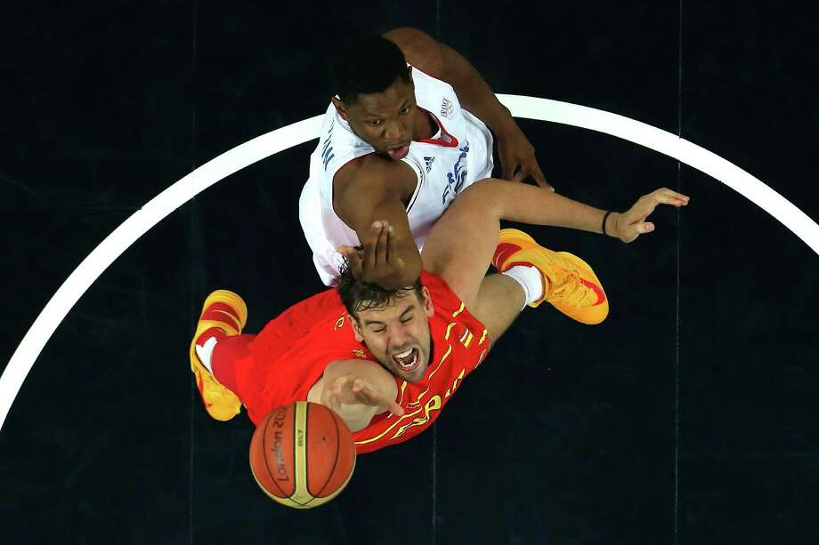 LONDON, ENGLAND - AUGUST 08:  Marc Gasol #13 of Spain goes up for the ball in front of Kevin Seraphin #4 of France during the Men's Basketball quaterfinal game on Day 12 of the London 2012 Olympic Games at North Greenwich Arena on August 8, 2012 in London, England. Photo: Ronald Martinez, Getty Images / 2012 Getty Images