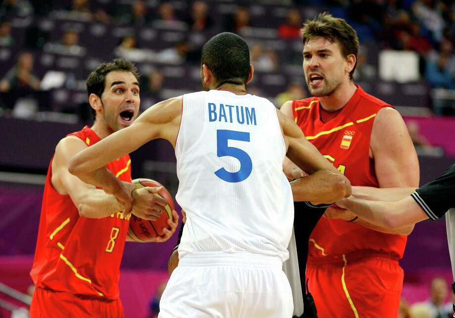 LONDON, ENGLAND - AUGUST 08:  Jose Calderon #8 and Marc Gasol #13 of Spain go after Nicolas Batum #5 of France after Batum fouled Juan-Carlos Navarro #7 late in the fourth quarter during the Men's Basketball quaterfinal game on Day 12 of the London 2012 Olympic Games at North Greenwich Arena on August 8, 2012 in London, England. Photo: Ronald Martinez, Getty Images / 2012 Getty Images