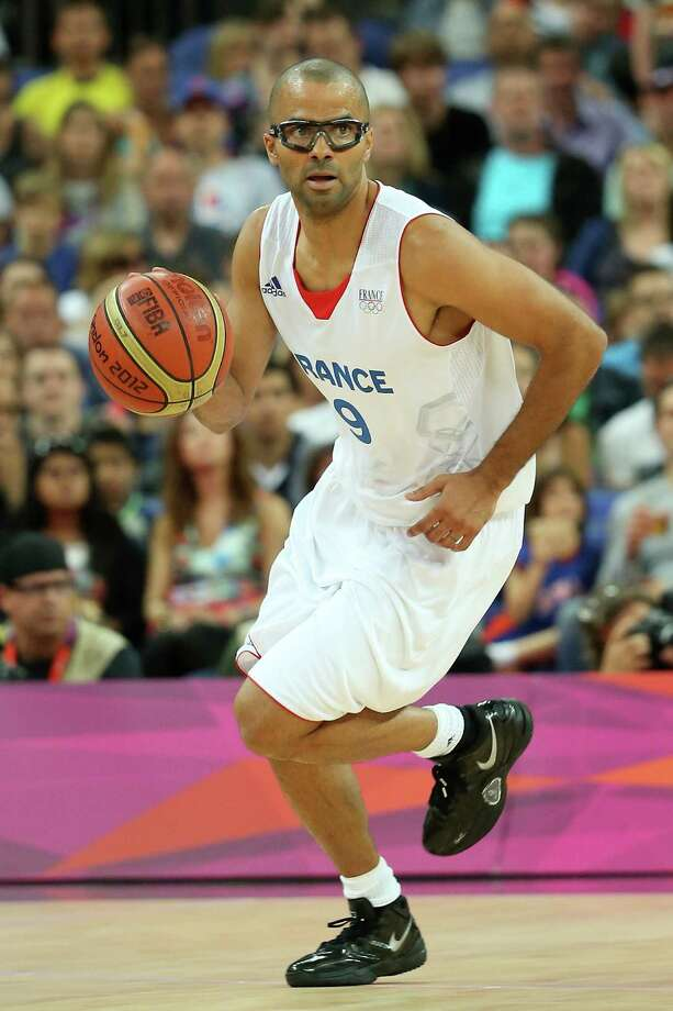 LONDON, ENGLAND - AUGUST 08:  Tony Parker #9 of France moves the ball in the first half while taking on Spain during the Men's Basketball quaterfinal game on Day 12 of the London 2012 Olympic Games at North Greenwich Arena on August 8, 2012 in London, England. Photo: Christian Petersen, Getty Images / 2012 Getty Images