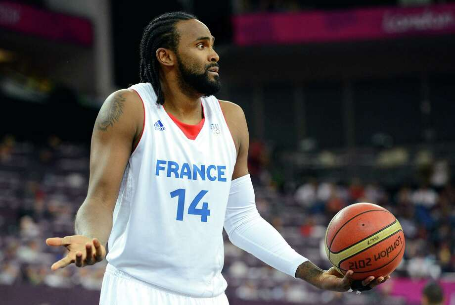 LONDON, ENGLAND - AUGUST 08:  Ronny Turiaf #14 of France reacts in the first half while taking on Spain during the Men's Basketball quaterfinal game on Day 12 of the London 2012 Olympic Games at North Greenwich Arena on August 8, 2012 in London, England. Photo: Ronald Martinez, Getty Images / 2012 Getty Images