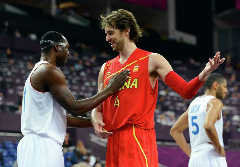 LONDON, ENGLAND - AUGUST 08:  Florent Pietrus #11 of France and Pau Gasol #4 of Spain exchange words in the first half during the Men's Basketball quaterfinal game on Day 12 of the London 2012 Olympic Games at North Greenwich Arena on August 8, 2012 in London, England. Photo: Ronald Martinez, Getty Images / 2012 Getty Images