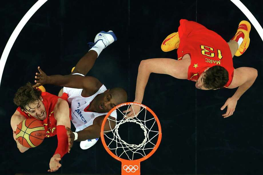 LONDON, ENGLAND - AUGUST 08:  Pau Gasol #4 of Spain goes up for a shot against Ali Traore #8 of France during the Men's Basketball quaterfinal game on Day 12 of the London 2012 Olympic Games at North Greenwich Arena on August 8, 2012 in London, England. Photo: Ronald Martinez, Getty Images / 2012 Getty Images