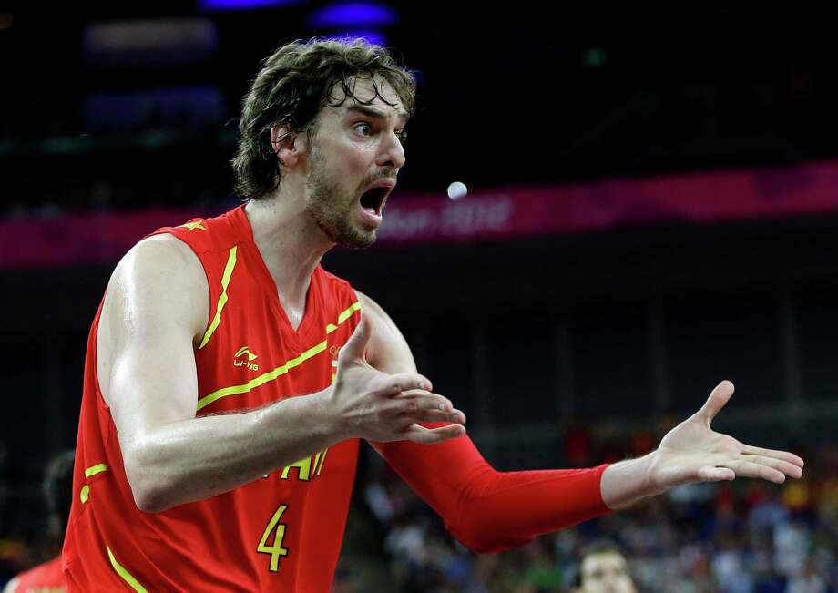 Spain's Pau Gasol argues a call during a quarterfinal men's basketball game against France at the 2012 Summer Olympics, Wednesday, Aug. 8, 2012, in London. (AP Photo/Eric Gay) Photo: Eric Gay, Associated Press / AP