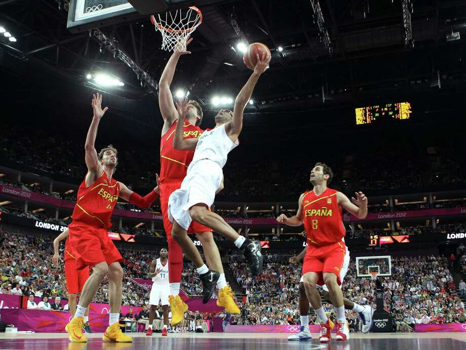 LONDON, ENGLAND - AUGUST 08:  Tony Parker #9 of France goes up for a shot against Marc Gasol #13 of Spain in the first half during the Men's Basketball quaterfinal game on Day 12 of the London 2012 Olympic Games at North Greenwich Arena on August 8, 2012 in London, England. Photo: Christian Petersen, Getty Images / 2012 Getty Images
