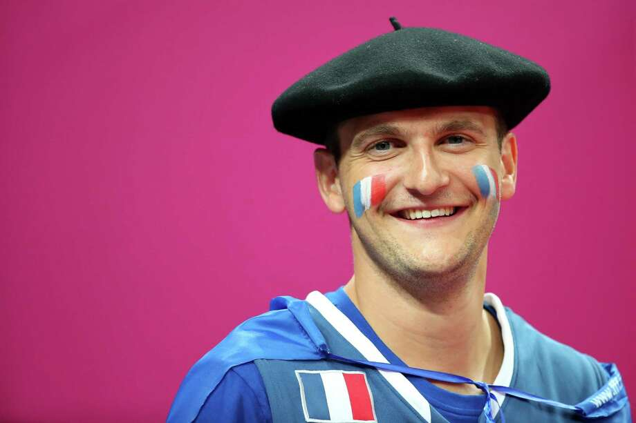 LONDON, ENGLAND - AUGUST 08:  A France fan smiles while taking on Spain during the Men's Basketball quaterfinal game on Day 12 of the London 2012 Olympic Games at North Greenwich Arena on August 8, 2012 in London, England. Photo: Christian Petersen, Getty Images / 2012 Getty Images