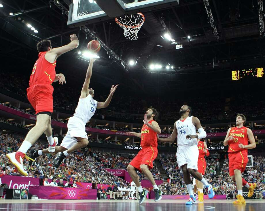 LONDON, ENGLAND - AUGUST 08:  Tony Parker #9 of France goes up for a shot against Rudy Fernandez #5 of Spain in the first half during the Men's Basketball quaterfinal game on Day 12 of the London 2012 Olympic Games at North Greenwich Arena on August 8, 2012 in London, England. Photo: Christian Petersen, Getty Images / 2012 Getty Images