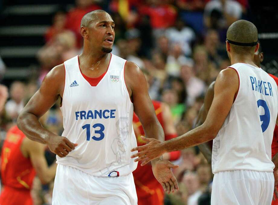 LONDON, ENGLAND - AUGUST 08:  Boris Diaw #13 and Tony Parker #9 of France celebrate a play in the first half against Spain during the Men's Basketball quaterfinal game on Day 12 of the London 2012 Olympic Games at North Greenwich Arena on August 8, 2012 in London, England. Photo: Ronald Martinez, Getty Images / 2012 Getty Images