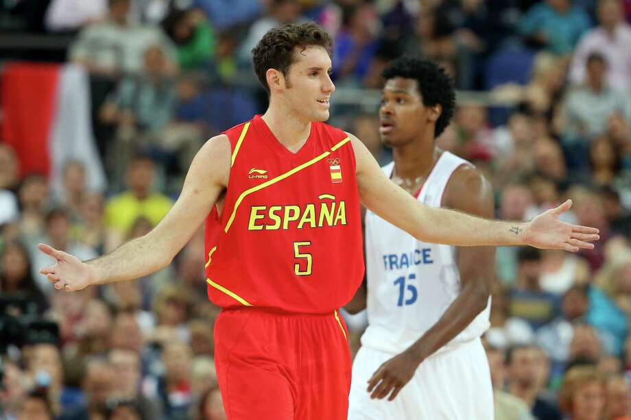 LONDON, ENGLAND - AUGUST 08:  Rudy Fernandez #5 of Spain reacts in front of Mickael Gelabale #15 of France in the first half during the Men's Basketball quaterfinal game on Day 12 of the London 2012 Olympic Games at North Greenwich Arena on August 8, 2012 in London, England. Photo: Christian Petersen, Getty Images / 2012 Getty Images