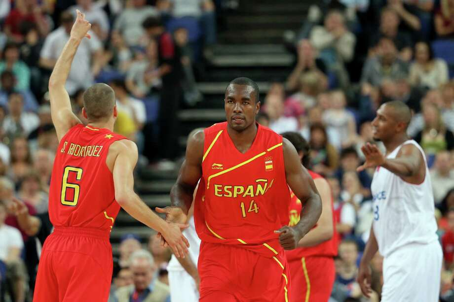 LONDON, ENGLAND - AUGUST 08:  Serge Ibaka #14 of Spain gives teammate Sergio Rodriguez #6 a five while taking on France in the first half during the Men's Basketball quaterfinal game on Day 12 of the London 2012 Olympic Games at North Greenwich Arena on August 8, 2012 in London, England. Photo: Christian Petersen, Getty Images / 2012 Getty Images