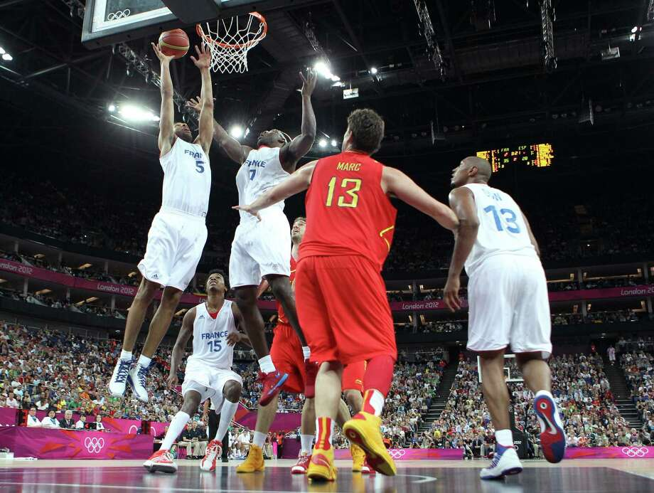 LONDON, ENGLAND - AUGUST 08:  Nicolas Batum #5 and Yakhouba Diawara #7 of France go for the ball against Marc Gasol #13 of Spain during the Men's Basketball quaterfinal game on Day 12 of the London 2012 Olympic Games at North Greenwich Arena on August 8, 2012 in London, England. Photo: Christian Petersen, Getty Images / 2012 Getty Images