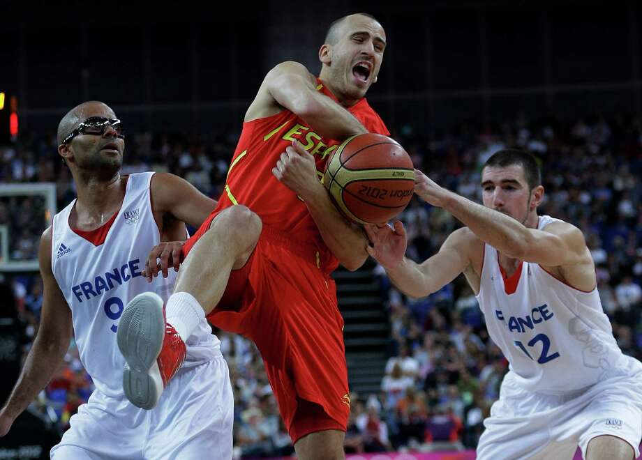 Spain's Sergio Rodriguez, center, loses control of the ball as France's Tony Parker, left, and Nando de Colo, right, pressure him during a quarterfinal men's basketball game at the 2012 Summer Olympics, Wednesday, Aug. 8, 2012, in London. (AP Photo/Eric Gay) Photo: Eric Gay, Associated Press / AP