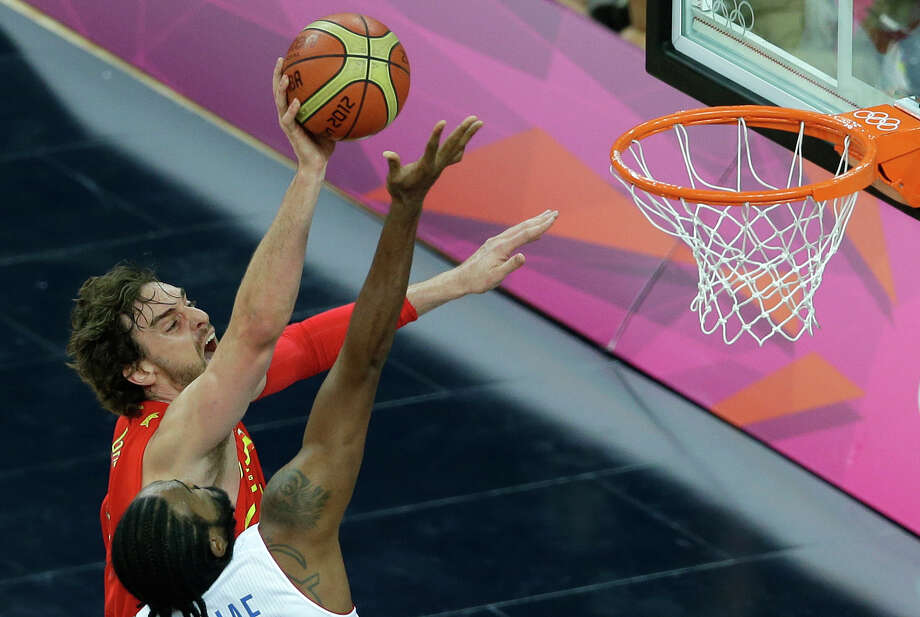 Spain's Pau Gasol, left, shoots over France's Ronny Turiaf during a quarterfinal men's basketball game at the 2012 Summer Olympics, Wednesday, Aug. 8, 2012, in London. (AP Photo/Victor R. Caivano) Photo: Victor R. Caivano, Associated Press / AP