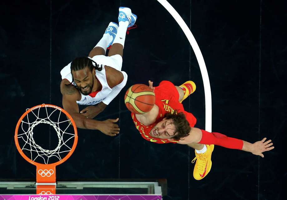 LONDON, ENGLAND - AUGUST 08:  Pau Gasol #4 of Spain goes up for a shot against Ronny Turiaf #14 of France in the first quarter during the Men's Basketball quaterfinal game on Day 12 of the London 2012 Olympic Games at North Greenwich Arena on August 8, 2012 in London, England. Photo: Ronald Martinez, Getty Images / 2012 Getty Images