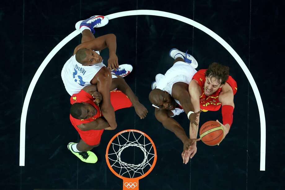 LONDON, ENGLAND - AUGUST 08:  Pau Gasol #4 of Spain goes up for a shot against Ali Traore #8 of France in the first half during the Men's Basketball quaterfinal game on Day 12 of the London 2012 Olympic Games at North Greenwich Arena on August 8, 2012 in London, England. Photo: Ronald Martinez, Getty Images / 2012 Getty Images