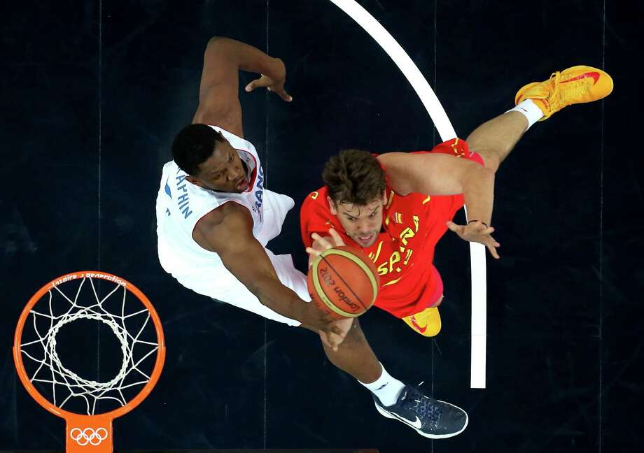 LONDON, ENGLAND - AUGUST 08:  Marc Gasol #13 of Spain goes up for a shot against Kevin Seraphin #4 of France in the first half during the Men's Basketball quaterfinal game on Day 12 of the London 2012 Olympic Games at North Greenwich Arena on August 8, 2012 in London, England. Photo: Ronald Martinez, Getty Images / 2012 Getty Images
