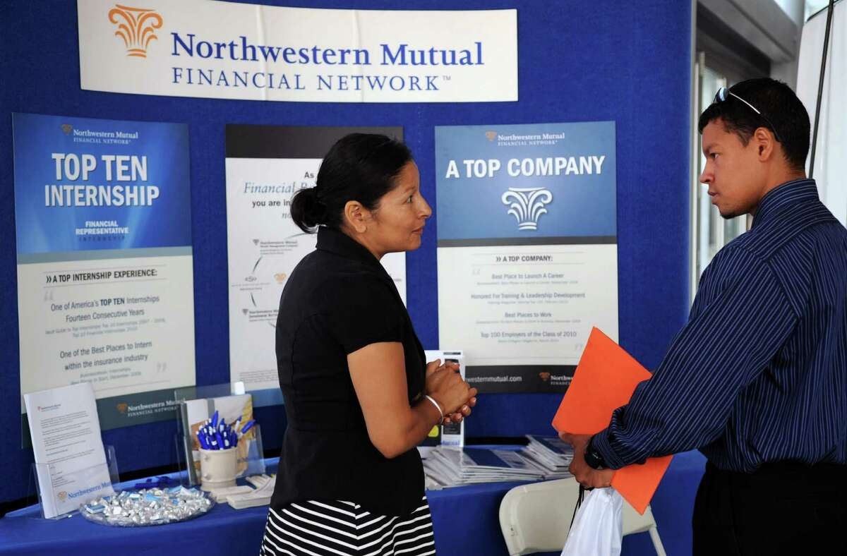Zuleyma Stryker, Campus Recruiter for Northwestern Mutual Financial Network, speaks to Edison Galindo, right, at the Veterans and Military personnel career fair at Harbor Point Square in Stamford on Wednesday, August 8, 2012.
