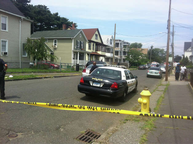 Bridgeport police investigate a shooting in the 500-block of Park Street on the afternoon of Wednesday, Aug. 8, 2012. Photo: Tom Cleary