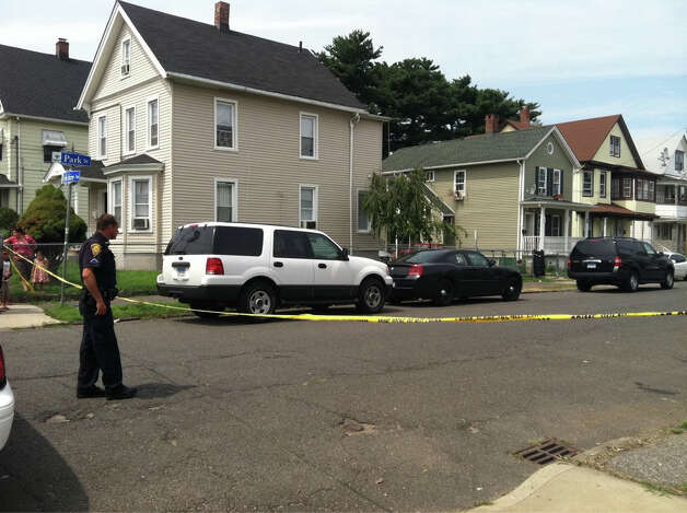 Bridgeport police investigate a shooting in the 500-block of Park Street on the afternoon of Wednesday, Aug. 8, 2012. Photo: Ali Reed/WTNH