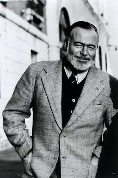 Ernest Hemingway stands on the Bridge of Sighs in Venice, Italy, in this 1950 file photo taken by his friend Aaron Edward Hotchner and released by the Library of Congress. Photo: A.E. HOTCHNER, AP / LIBRARY OF CONGRESS