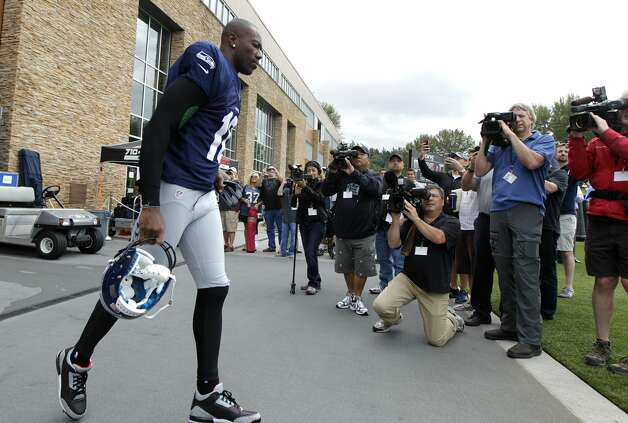 Seattle Seahawks' Terrell Owens heads out to the field during NFL football training camp, Wednesday, Aug. 8, 2012, in Renton, Wash. (Ted S. Warren / Associated Press)