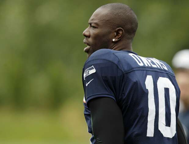Seattle Seahawks' Terrell Owens stands on the field as stretching drills begin at the start of NFL football training camp, Wednesday, Aug. 8, 2012, in Renton, Wash. (Ted S. Warren / Associated Press)