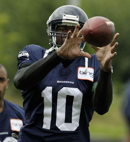 Seattle Seahawks' Terrell Owens catches a football during stretching drills at the start of NFL football training camp, Wednesday, Aug. 8, 2012, in Renton, Wash. (Ted S. Warren / Associated Press)
