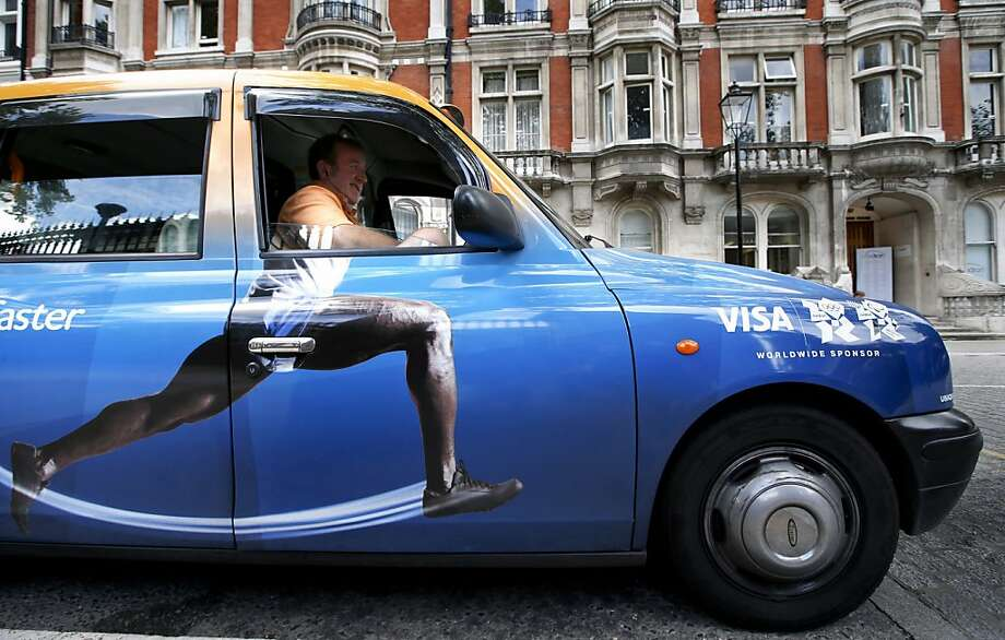 Taxi driver Richard Meid waits for a fare in front of the British Museum during the 2012 Summer Olympics,Wednesday, Aug. 8, 2012, in London. (AP Photo/Jae C. Hong) Photo: Jae C. Hong, Associated Press