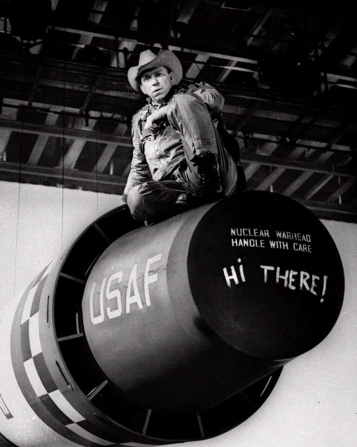 "Actor Slim Pickens sits atop a nuclear weapon prop during production of the movie ""Dr. Strangelove or: How I Learned to Stop Worrying and Love the Bomb."" (AP Photo) Photo: EXPRESS-NEWS FILE PHOTO / AP"