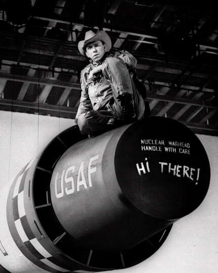 Actor Slim Pickens sits atop a nuclear weapon prop during production of the movie