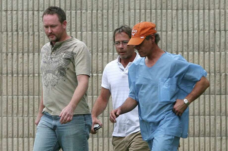 Randy Travis, far right exits the Grayson County jail with two unknown persons Wednesday Aug. 8, 2012, in Sherman, Texas, after being arraigned on charges of driving while intoxicated and retaliation. (AP Photo/The Herald Democrat, Chris Jennings) TV OUT; MAGS OUT; TV AND MAGAZINE CALL FOR RATES TERMS;MANDATORY CREDIT Photo: Chris Jennings, Associated Press / The Herald Democrat