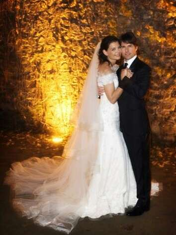 Tom Cruise and Katie Holmes were married at the beautiful Odescalchi Castle in Bracciano, Italy in 2006. Katie wore a Giorgio Armani off-the-shoulder gown adorned with Valenciennes lace and Swarovski crystals. Tom wore a navy, two-button Armani tux. Photo: Handout, Getty Images