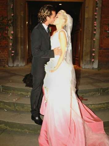 A decade ago, in 2002, Gwen Stefani and Gavin Rossdale tied the knot at St. Paul's Church, in London. Gwen looked stunning in her custom-made, pink and white wedding dress designed by John Galliano for Dior. While Gavin kept his look traditional Brit. He even walked down the aisle with his sheepdog, Winston. Photo: Thomas Rabsch, Getty Images