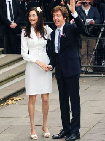 In 2011, Nancy Shevell and Paul McCartney tied the knot at the Old Marylebone Town Hall in London, in front of 30 friends and family members. Nancy wore a classic, ivory dress, designed by Stella McCartney (the groom's daughter), while Sir Paul opted for a simple navy suit. Photo: PacificCoastNews.com, Pacific Coast News