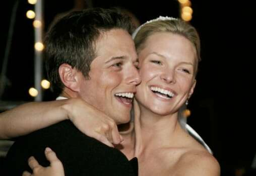'Party of Five' star Scott Wolf and his reality star wife Kelley (pictured here on their wedding day in 2004) welcomed their third child, a daughter named Lucy Marie, on May 24.  Photo: AP