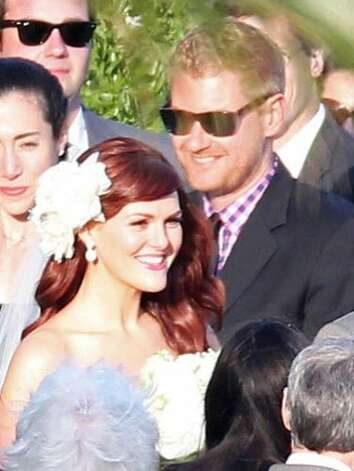 Sara Rue and Kevin Price met during a game of beer pong at a Fourth of July party. They commemorated the moment at their 2011 Pacific Palisades wedding by incorporating a customized beer-pong table with matching paddles into the festivities. Photo: Gaz Shirley/Jeff Steinberg, Paci, Pacific Coast News