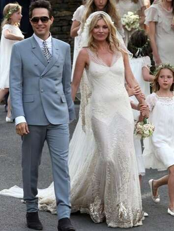 A-list couple Kate Moss and Jamie Hince married in the English countryside in 2011. The supermodel wore a delicate, embellished dress designed by John Galliano, and rock star wore a light blue suit designed by Yves Saint Laurent creative director Stefano Pilati. Photo: Neil Mockford, Getty Images