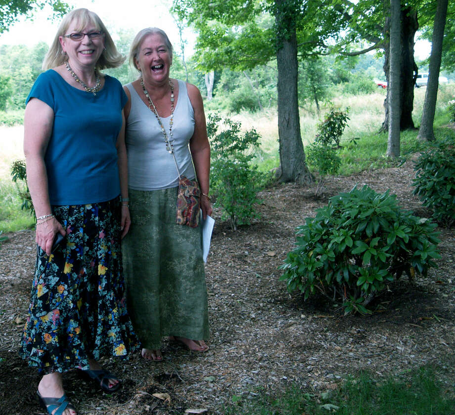 Garden dedication  Ann Wagner, left, president of the Roxbury-Bridgewater Garden Club and club member Barbara Lang, a partner in Brandywine Landscape Design, proudly share their sentiments about the club's garden during the dedication ceremony. July 2012  Courtesy of the Roxbury-Bridgewater Garden Club Photo: Contributed Photo
