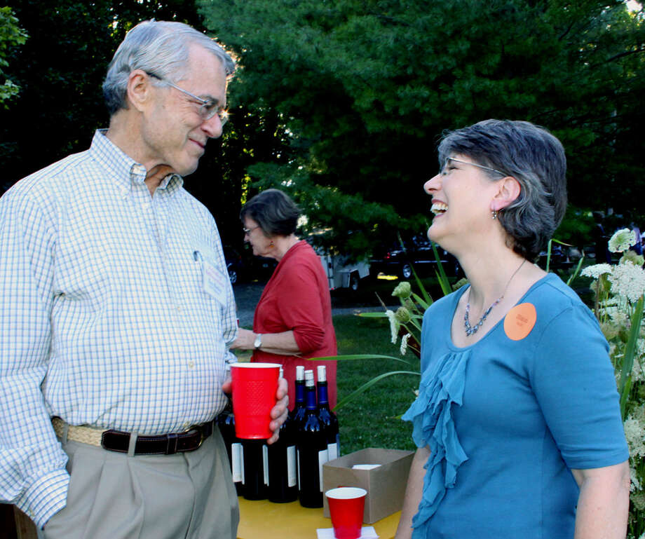 Bob Bailey, the president of the Friends of Sullivan Farm, shares a light moment with Sharon Sullivan Racis, who grew up on the farm and recently authored a history of the farm. July 21, 2012 at the Farmer's Table dinner. Photo: Walter Kidd