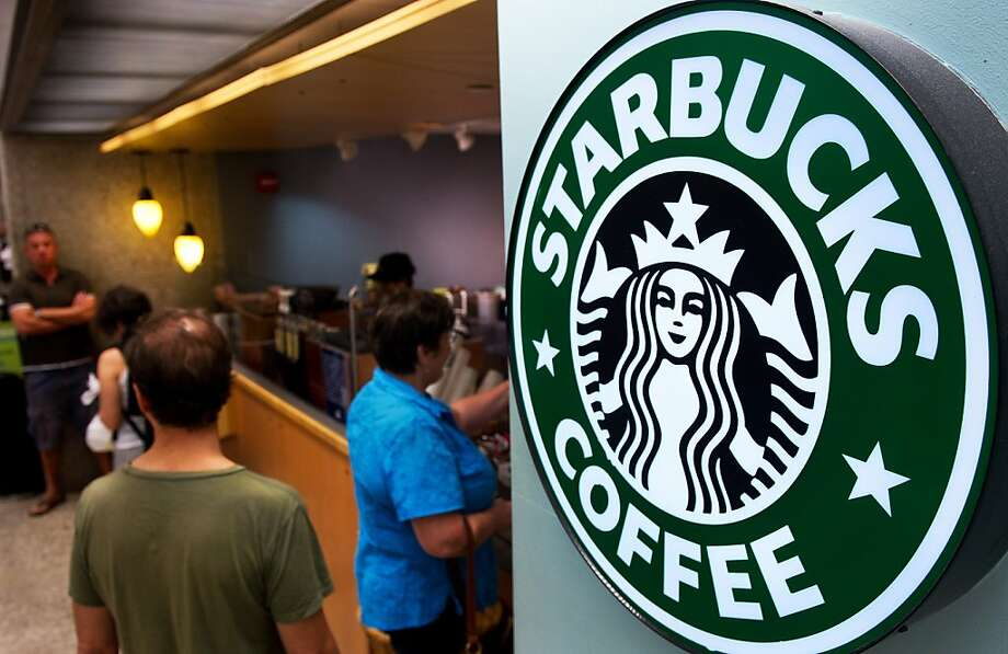 Customers queue for coffee at Starbucks Coffee inside the Dulles International Airport complex in this August 30, 2011 file photo in Dulles, Virginia, near Washington, DC.  Starbucks is pouring $25 million into electronic payments start-up Square in a partnership that expands mobile payment options at the coffee chain, the companies announced August 8, 2012. Starbucks customers will be able to use the Pay with Square mobile application to buy their Java beginning in the fall, and find nearby Starbucks locations via Square Directory. Meanwhile Square will process Starbucks US credit and debit card transactions, sharply expanding Square's scale and, in turn, lowering Starbucks's payment processing costs. Starbucks has been a pioneer in mobile payments, with a mobile phone application usable in the United States and Canada, and since the beginning of the year in Britain. AFP Photo/Paul J. RichardsPAUL J. RICHARDS/AFP/GettyImages Photo: Paul J. Richards, AFP/Getty Images