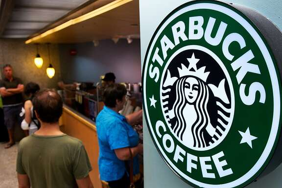 Customers queue for coffee at Starbucks Coffee inside the Dulles International Airport complex in this August 30, 2011 file photo in Dulles, Virginia, near Washington, DC.  Starbucks is pouring $25 million into electronic payments start-up Square in a partnership that expands mobile payment options at the coffee chain, the companies announced August 8, 2012. Starbucks customers will be able to use the Pay with Square mobile application to buy their Java beginning in the fall, and find nearby Starbucks locations via Square Directory. Meanwhile Square will process Starbucks US credit and debit card transactions, sharply expanding Square's scale and, in turn, lowering Starbucks's payment processing costs. Starbucks has been a pioneer in mobile payments, with a mobile phone application usable in the United States and Canada, and since the beginning of the year in Britain. AFP Photo/Paul J. RichardsPAUL J. RICHARDS/AFP/GettyImages