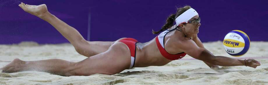 United States' Misty May-Treanor dives for a ball during the women's gold medal beach volleyball match against the other US team `at the 2012 Summer Olympics, Wednesday, Aug. 8, 2012, in London. Photo: Ap