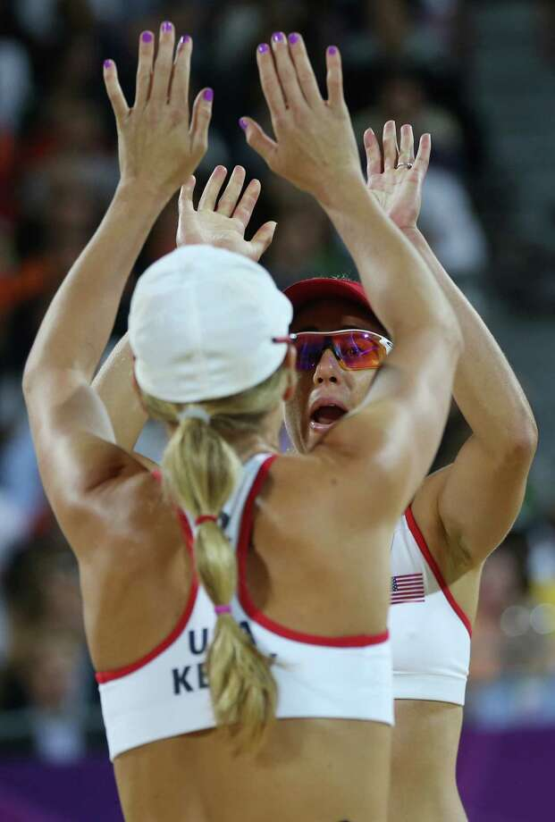 United States' Jennifer Kessy, left, and April Ross, right, react during the women's gold medal beach volleyball match against the other US team at the 2012 Summer Olympics, Wednesday, Aug. 8, 2012, in London. Photo: Ap