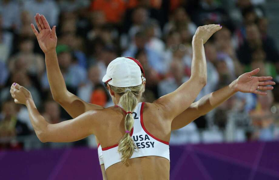 United States' Jennifer Kessy, front, and April Ross, back react during the women's gold medal beach volleyball match against the other US team at the 2012 Summer Olympics, Wednesday, Aug. 8, 2012, in London. Photo: Ap