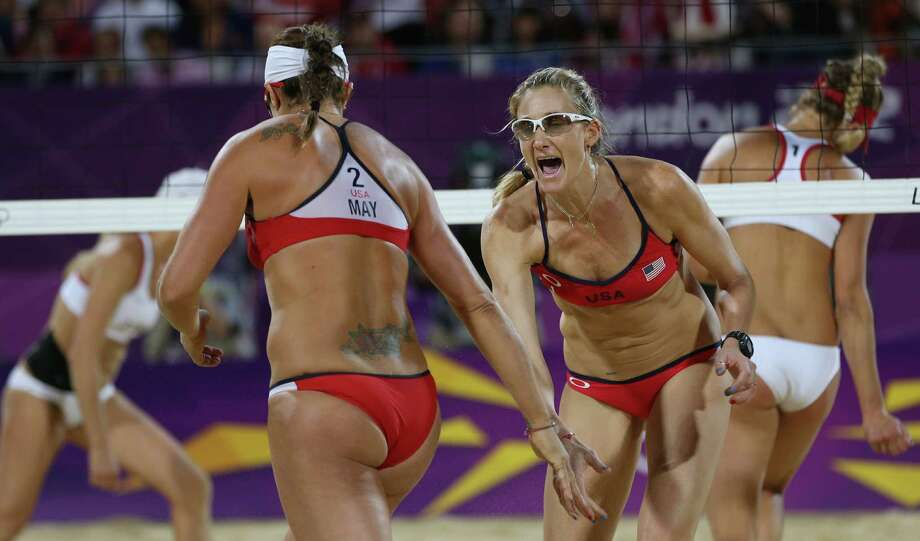 United States' Kerri Walsh Jennings, right, and Misty May-Treanor, left, react during the women's gold medal beach volleyball match against the other US team at the 2012 Summer Olympics, Wednesday, Aug. 8, 2012, in London. Photo: Ap