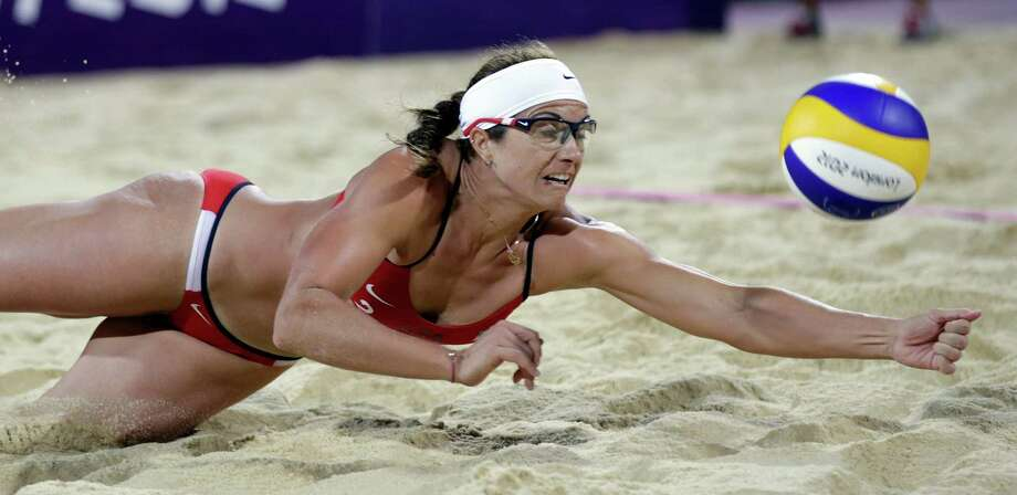 Misty May Treanor digs out a ball during the women's Gold Medal beach volleyball match between two United States teams  at the 2012 Summer Olympics, Wednesday, Aug. 8, 2012, in London. Photo: Ap
