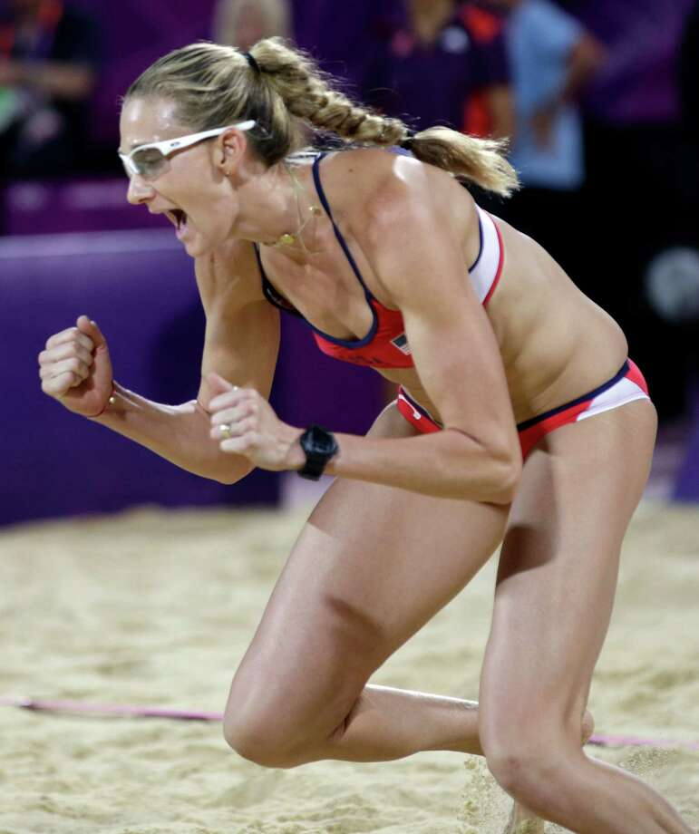 Kerri Walsh Jennings reacts after scoring a point during the women's Gold Medal beach volleyball match between two United States teams  at the 2012 Summer Olympics, Wednesday, Aug. 8, 2012, in London. Photo: Ap