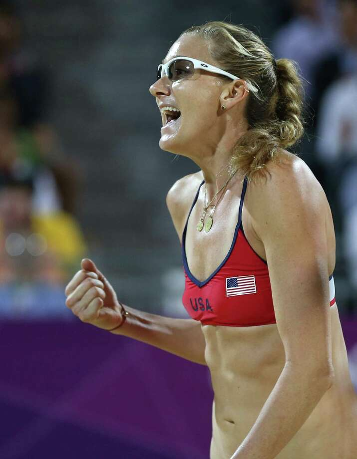 United States' Kerri Walsh Jennings reacts during the women's gold medal beach volleyball match against the other US team at the 2012 Summer Olympics, Wednesday, Aug. 8, 2012, in London. Photo: Ap