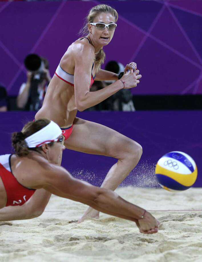 United States' Kerri Walsh Jennings, right, looks on as Misty May-Treanor, left, dives for a ball during the women's gold medal beach volleyball match against the other US team at the 2012 Summer Olympics, Wednesday, Aug. 8, 2012, in London. Photo: Ap