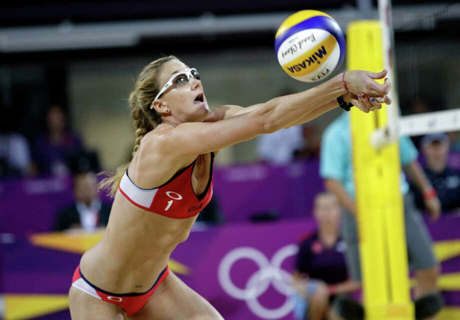 Kerri Walsh Jennings sets the ball during the women's Gold Medal beach volleyball match between two United States teams  at the 2012 Summer Olympics, Wednesday, Aug. 8, 2012, in London. Photo: Ap